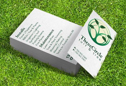 Custom printed premium business cards in grass field