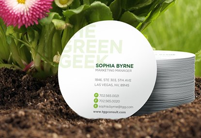 Custom printed circular business cards in a garden