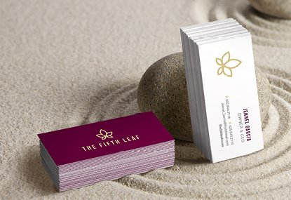 Custom printed miniature slim business cards in a zen garden